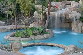 inground pools with waterfalls and hot tubs. 14-A-hot-tub-and-waterfall-feature-add-to-the-granduer-of-your-backyard-pool Inground Pools With Waterfalls And Hot Tubs L