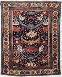 antique bidjov rug northeast caucasus 61 1 2 x 48 1 2 wool on wool dark blue ground ivory primary border secondary colors of blues rust salmon