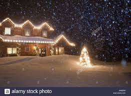 Lights That Look Like Snow Falling Log Home Decorated With Christmas Lights With Snow Falling