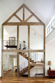 Wood stairs and a wood house skeleton by Ritch Holben of Rh Design from  Barn-