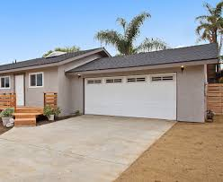 the overhead garage door was invented in 1921 by c g johnson only 5 years later in 1926 he invented the first electric garage door opener so we wouldn t