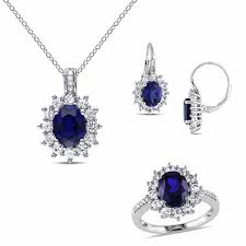oval lab created blue and white sapphire with diamond accent frame pendant ring and earrings set in sterling silver