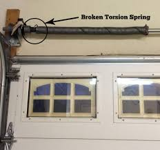 garage door tension springBroken Garage Door Torsion Springs in Austin  Before  After