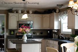 Decorating Above Kitchen Cabinets With High Ceilings Enclose Space