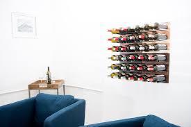 cork out grain rod metal and wood wine rack panel