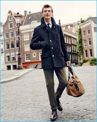 clément chabernaud takes to the streets of amsterdam in a navy peacoat from j crew