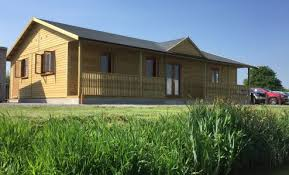 wooden office buildings. interesting buildings set in a stunning waterside location this pavilion is used as refectory  building at and wooden office buildings