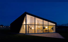 example of modern scandinavian architecture: Still keeps the sharp angles  and triangular roof. Use of textured wood.