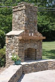 interesting outdoor living space decoration with masonry outdoor fireplace design breathtaking image of light brown