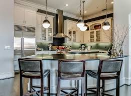transitional kitchen with curved peninsula and black granite counter