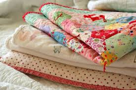 How to Hand Tie a Quilt: 7 Steps & Patterned Quilts Folded and Stacked Adamdwight.com