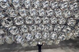 engineer volkmar dohmen stands in front of xenon short arc lamps