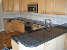 simple kitchen with dark grey granite countertops utah maple wood kitchen cabinets and stainless steel electric range