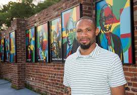 to enlarge artist hamilton gl stands by the legacy wall outside the bon secours sarah garland jones center