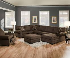 sofa ottoman in the middle room and white fur rug plus gray furniture modern minimalist design with dark brown u shaped couch with recliner and footrest