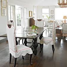 dining chair slipcovers with c piping lighten the formal feel in a neutral dining room