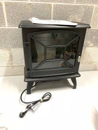 freestanding electric fireplace heater in black pick up only