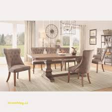 bring some glamour to your dining room with this gorgeous homevance es furniture set in warm