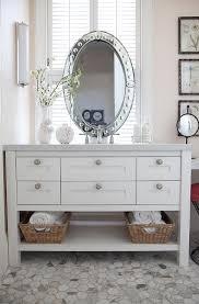 bathroom vanity mirror in front of window