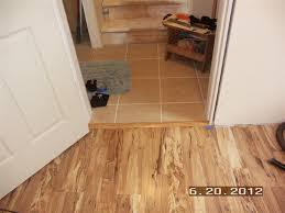 hardwood floor transition from room to hallway
