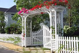 beautiful white garden fence with gated pergola