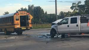 Pickup truck hits school bus at Haverhill and Southern | WPEC