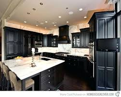 black cabinets white countertops tactacco