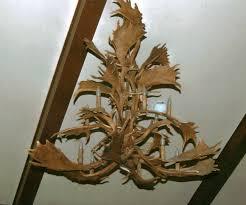 2 tier fallow antler chandelier 12 lights 54 diameter x 50 tall