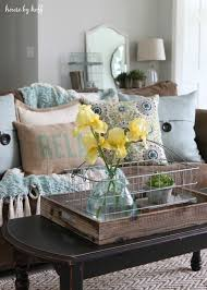 cream couch living room ideas: light blue and yellow nice accent colors with a brown sofa summer living room