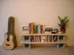 Small Cinder Block Shelves With Light Maple Wood Planks To Put Your Book  Collections On Cream Stone Flooring Idea