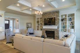 Traditional Living Room with stone fireplace, Chandelier, Built-in  bookshelf, Carpet,