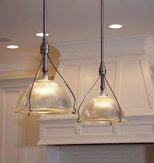 graceful frames support the remarkable vertical cut glass domes of these vintage original holophane light