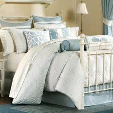 bedroom grey bedding sets with carved white iron bed on blue rug