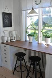 I like window/breakfast bar/counter space combo.