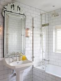 bathroom with white subway tiles and dark grout