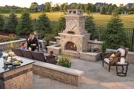 outside fireplaces are impactful for creating warm landscape designs