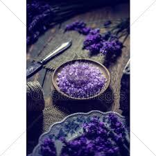bath salt in wooden bowl and fresh lavender flo