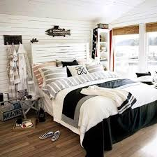 Funny Nautical Bedroom For Kid With Black Fish On The White Wall