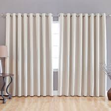 interior white curtains on stainless steel hook connected by beige wooden laminate floor and grey