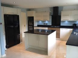 black appliances in white kitchen