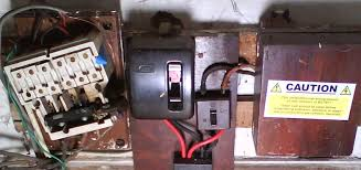 old electrical fuseboxes and switchgear double pole fuseboxes and switches caution should have been replaced 40 years ago