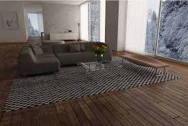 checkerboard patchwork cowhide rug with dark wooden plank floor
