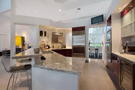 Kitchen islands with breakfast bar Modern Kitchen With Bianco Romano Granite Breakfast Bar Island Designing Idea 37 Gorgeous Kitchen Islands With Breakfast Bars pictures