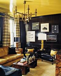 Stunning dining room in black with hints of gold View in gallery Ceiling  also adds golden glint to the living room [Photography by Eric Piaseck]