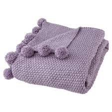 layer up your bed with super soft knits this indulgent throw is trimmed with handmade pom poms for a touch of individuality and fun