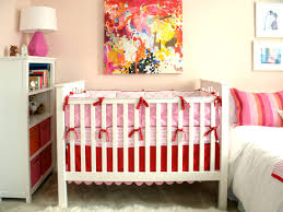 White Crib with Pink and Red Bedding