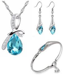om jewells blue rhinestone party wear jewellery combo of aqua drop pendant necklace set with cuff bracelet for girls and women co1000064c om jewells