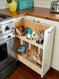 creative kitchen cabinet storage ideas: pull-out utensil bin is a clever  alternative to the traditional corner-cabinet lazy Susan.