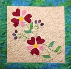 Simple fusible web applique and easy hand embroidery stitches ... & Simple fusible web applique and easy hand embroidery stitches create this  floral design. Spring Hearts Adamdwight.com
