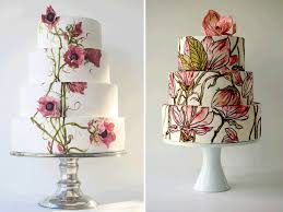 White Wedding Cakes Adorned With Colorful Flowers And Butterflies